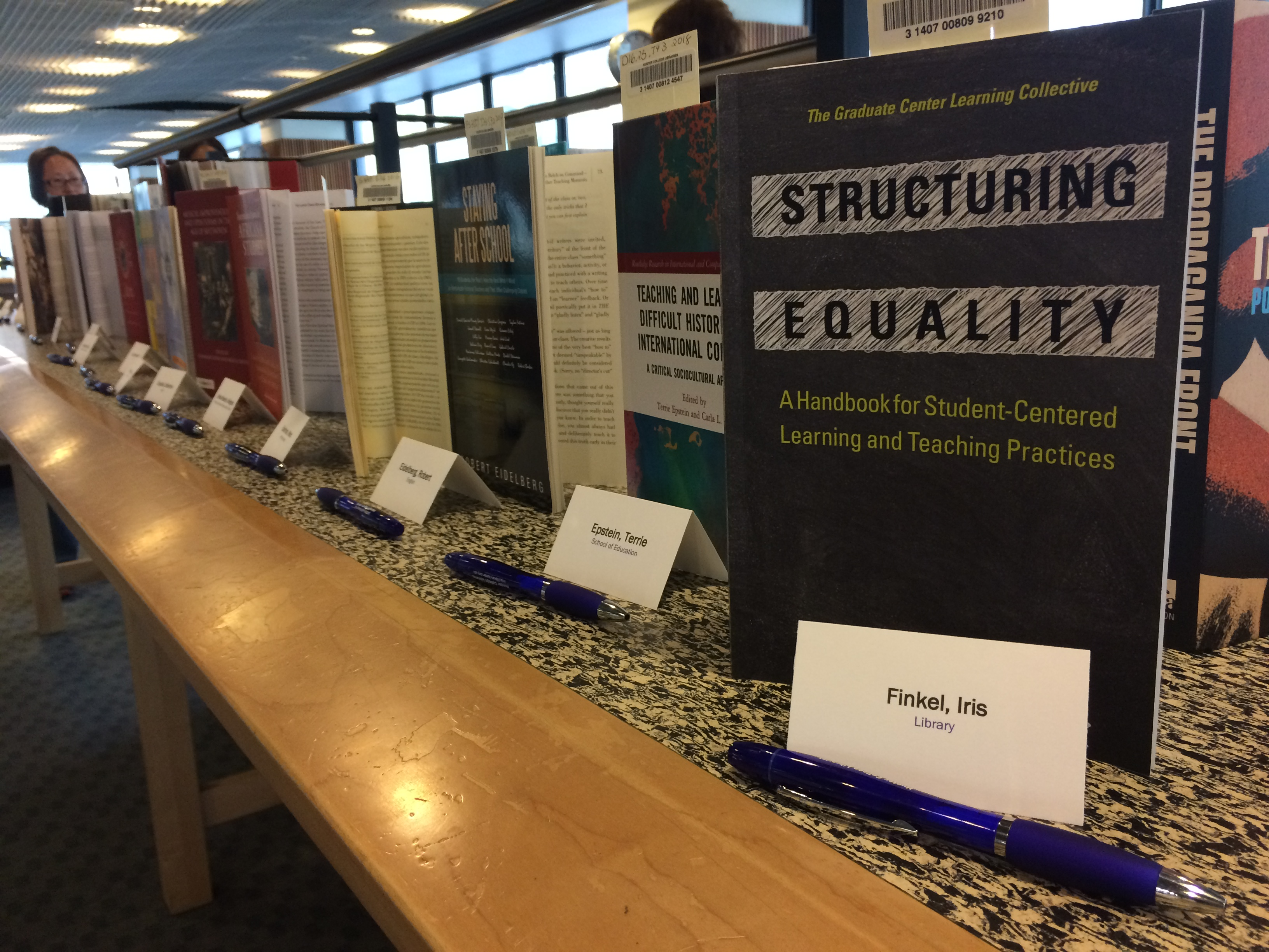 image of books published by Hunter College faculty members